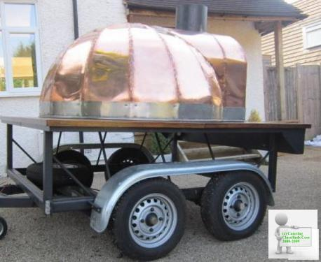 WOOD FIRED PIZZA OVEN FOR HIRE FOR YOUR EVENT AMAZING COPPER FRONT